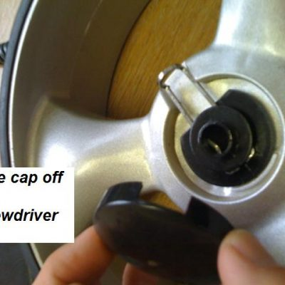 Remove Golf Trolley Wheel Cap for access to wheel clip