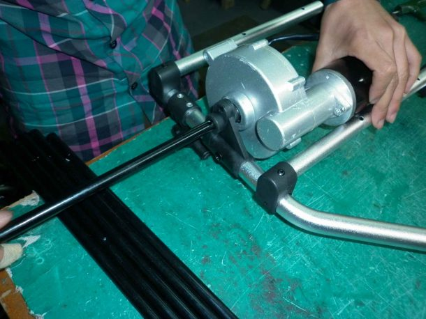 Golf trolley axle slides into place